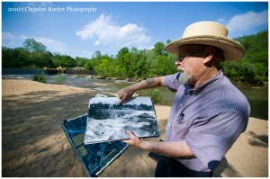 Jim Rumley shows archival photos from BullHole at Cooleemee River Park